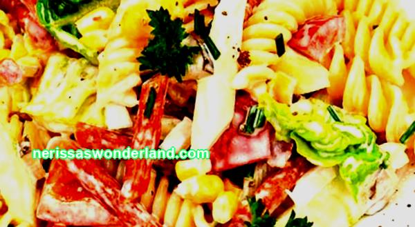 Festive salad with pasta and sausage
